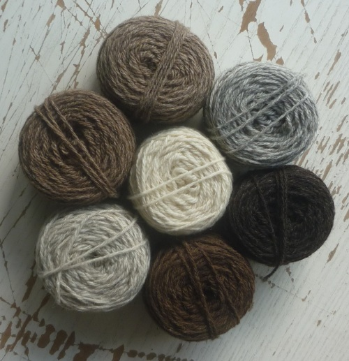 balls of Foula wool in 7 natural shades