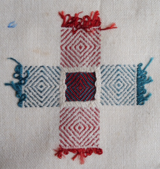 Darning sampler 1892 bird's eye darn back