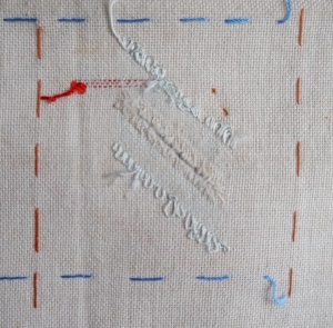 Darning sampler 1892 diagonal slash darn back