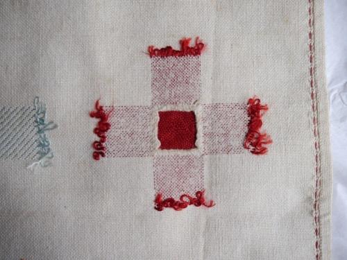 Darning sampler 1892 even weave darn back