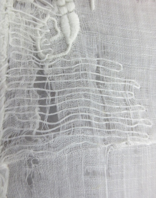 muslin handkerchief repair close-up