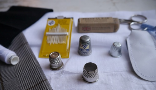 Thimbles, needles, beeswax