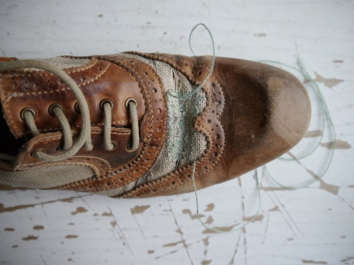 Canvas and leather shoe repair WIP closeup