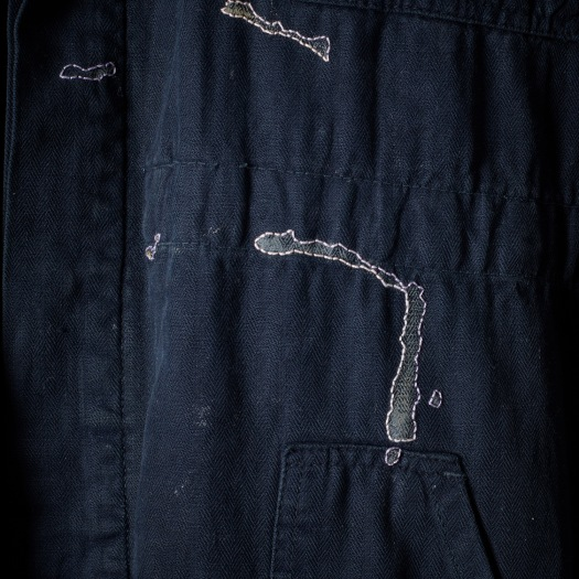 Tom of Holland boilersuit for The New Craftsmen, with textured layers, detail of stain
