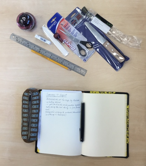 bookbinding tools and notebook