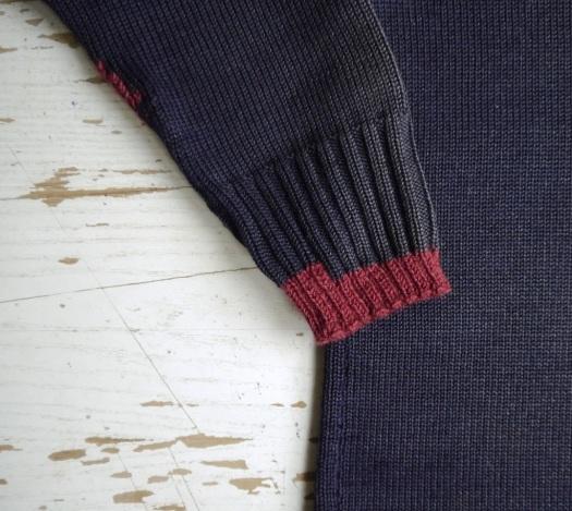 visible mending gansey - stepped cuff repair